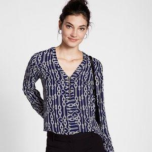 Express rope print half zip blouse